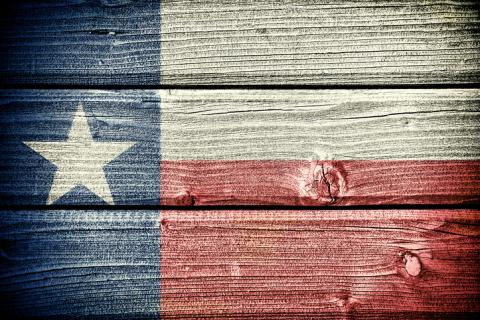 Texas flag painted on wood siding